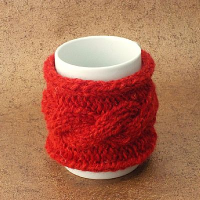 cable design red wool mug cosy by roses workshop
