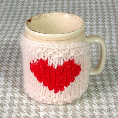 knitted wool mug cosy with red heart