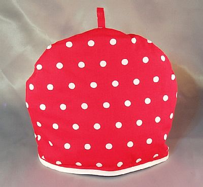 tea cosy red fabric with white spost