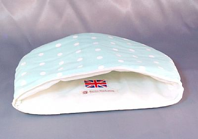 showing white fabric inside of dotty cosy