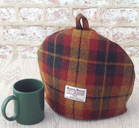 harris tweed tea cosy in autumn red gold green check