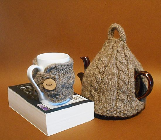 knitted tea cosy and matching mug cosy by roses workshop