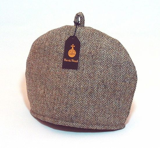 harris tweed tea cosy in lovat green herringbone by roses workshop
