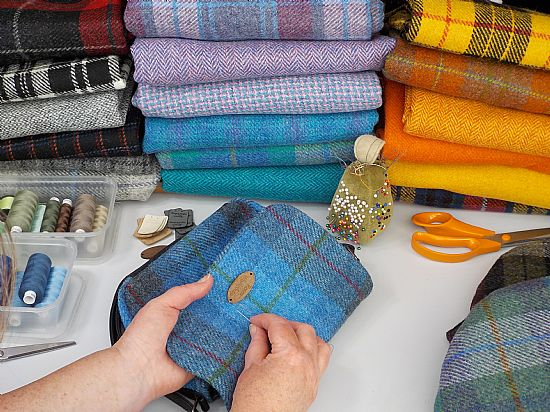 many colourful designs of harris tweed fabric made into lovely items at roses workshop studio