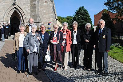 museum volunteers attend remembrance service
