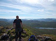 George Linton on Bidean a' Choire Sheasgaich. Skye on the far horizon.