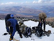 Putting on crampons for the top part of the 'Tourist Path', Ben Nevis.