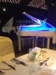Our Digital white grand pianoa