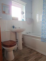 Bathroom with full size bath