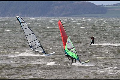 windsurfers and a kitesurfer enjoying the conditions off fort george