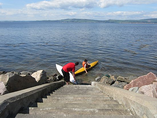 launching canoes from the steps opposite the cottage