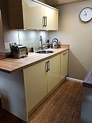 Kitchen with new countertop, electric kettle, toaster and on demand hot water