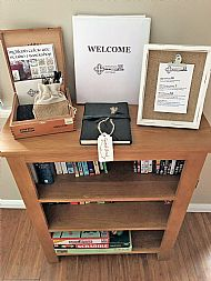 Welcome booklet, guest book, games and books