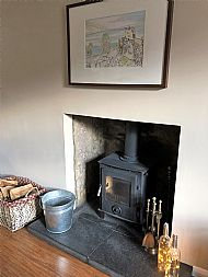 Superb log burner and art by Maryjory Tait