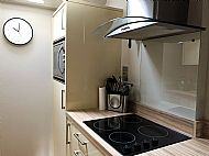 The kitchen is very well equipped with ceramic hob and high quality built in combination oven with microwave and grill.