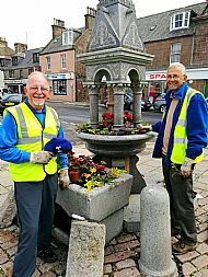 Volunteers planting up the Market Square fountain and trough with summer bedding plants -- 13 June 2017. Photo by Julie Lomax.