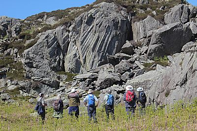 wgs members admire the impressive fanned columnar calling joints in welded ignimbrite of the stickle pike member, lickle formation