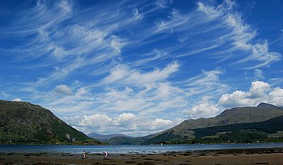 view from bays and bens holidays, airds bay, taynuilt, nr oban, self catering holiday let accommodation.  looking down loch etive, blue skies with whispy clouds.  ben cruachan on the right and ben duirinish on the left