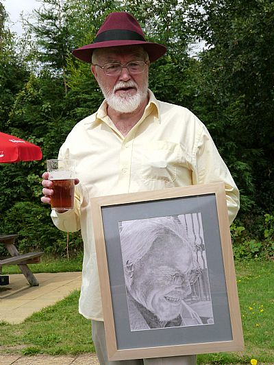 john with ray's portrait