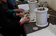 A hush falls as the magic of drawing with wax begins