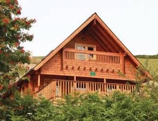 find log cabins with hot tubs in cardiganshire