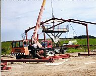 The first shed going up August 2004