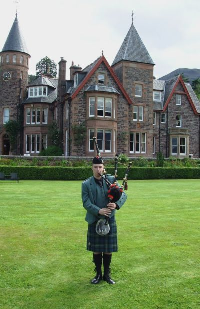 wedding piper, alasdair turner - playing at the loch torridon hotel,  voted hotel of the year and wedding hotel of the year.