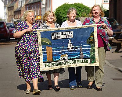 photo of banner and four of the crafters