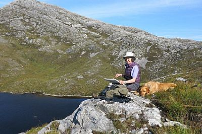 gillian sketching the hills and loch