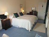 Kingsize bed in Blue MacNeil bedroom