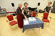 Cutting the 95th cake