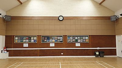 three quilt panels hanging in findon hall