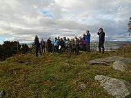 On top of the chambered cairn - the capstone can be seen to the right
