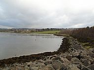 View looking towards Findon Mains across the exit from the quarry, showing the extent of the infill hiding the old pier.