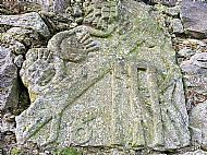 Carved stone in steading wall, Meikle Findon