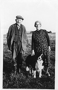 HPA041   Anna-May and Andrew Slater. The dog is  Ben. Small shop at Otterswick