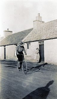 HPA166   Lillian Hay (on bike) and  Minna Hay, Kettletoft (their birthplace)