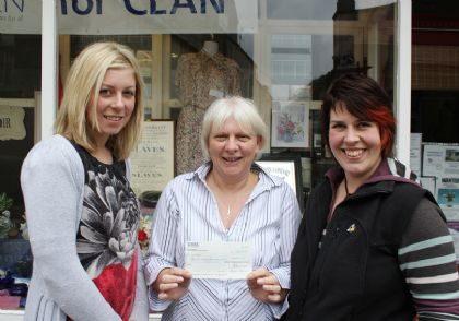 handing over the cheque to clan