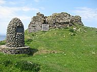Cairn celebrating the hereditary Macdonald Clan pipers, MacArthurs along side the ruins of Duntulm Castle.