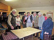 Members admiring a geanological chart of the Macdonalds