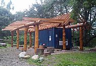 Evanton Community Woodland log frame over a shipping container