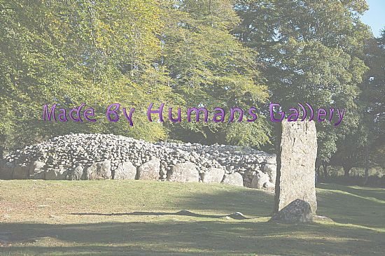 at clava cairns and looking at a cairn and a standing stone