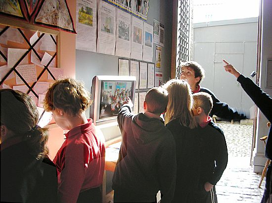 schoolchildren actively engaged with the slave trade exhibition