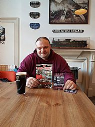 Tosh with book, beer and flyer at the Parcel Yard Pub London before the book launch on 11.11.17