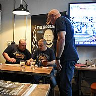 Tosh & Gilly signing book to Rob Silvester(Portsmouth) author of Rolling with the 6.57 Crew at the launch