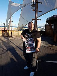 author-tosh-mcintosh-with-tfbg-book-poster at jolly roger restaurant bourgas