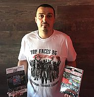 author-gilly-black-holding-jrf-bth-both book editions-english and bulgarian-wearing tfbg white tshirt- home in varna