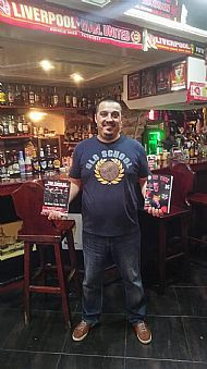 author-gilly-black-holding-both tfbg-ostl-book- bulgarian and english editions- in three lions pub varna