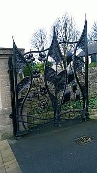 The design of the cemetery gates is striking