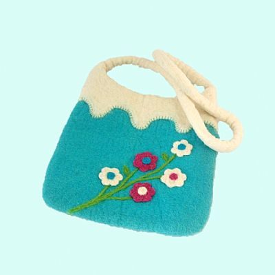 blue felt bag with white handle and needlefelted flowers by roses felt workshop